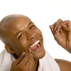 See how happy this guy is because he's flossing? You, too, can be just as happy.