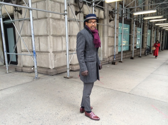 Hat by Rag & Bone, scarf by Target, topcoat by J.Crew, trousers (part of suit), monk strap shoes by Sergio Rossi, gloves by Banana Republic