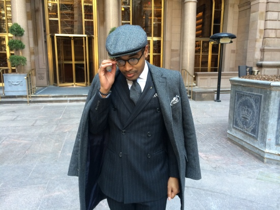 Cap by Fine & Dandy, coat by J.crew, suit by Burberry, shirt by Piatelli, tie by Ike Behar