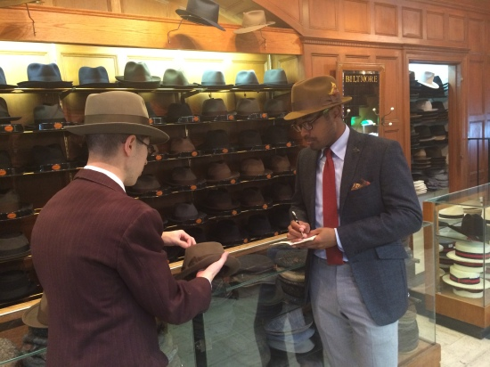 Chatting with staff at JJ Hat Center